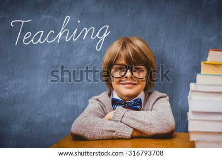 The word teaching and pupil with many books against blue chalkboard