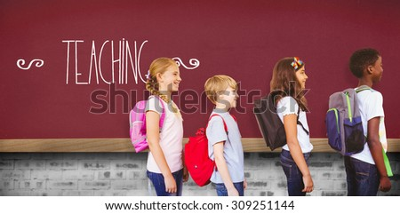 The word teaching and school kids standing in school corridor against red background - stock photo
