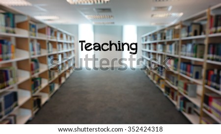 """The word """"teaching"""" in a background of blurry library books shelves. - stock photo"""