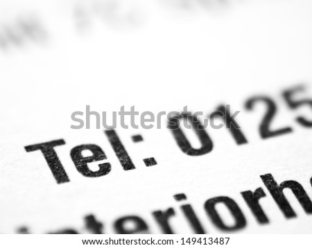 The word TEL closeup on a printed document.
