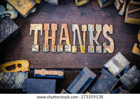 The word THANKS written in rusted metal letters surrounded by vintage wooden and metal letterpress type. - stock photo