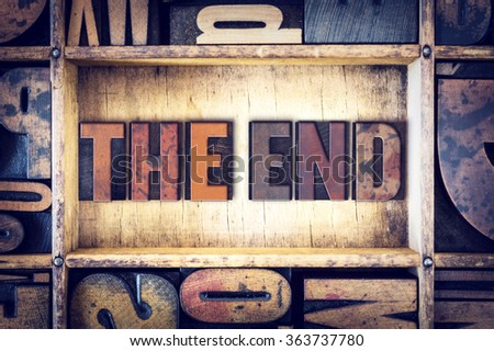 """The word """"The End"""" written in vintage wooden letterpress type. - stock photo"""