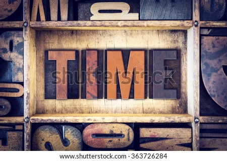 """The word """"Time"""" written in vintage wooden letterpress type. - stock photo"""