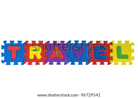 "The word ""Travel"" written with alphabet puzzle letters isolated on white background"