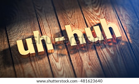 "The word ""uh-huh"" is lined with gold letters on wooden planks. 3D illustration image"