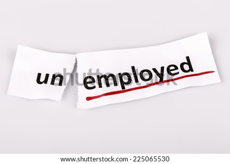 The word unemployed changed to employed on torn paper and white background - stock photo