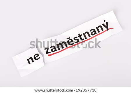 The word unemployed changed to employed on torn paper and white background in czech language