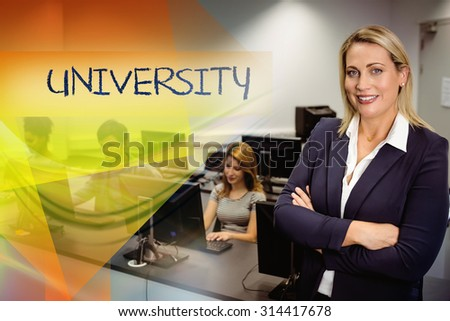The word university against computer teacher smiling at camera with arms crossed - stock photo