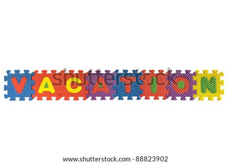 "The word ""Vacation"" written with alphabet puzzle letters isolated on white background"