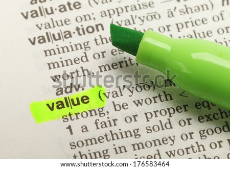 The Word Value Highlighted in Dictionary with Green Marker Highlighter Pen. - stock photo
