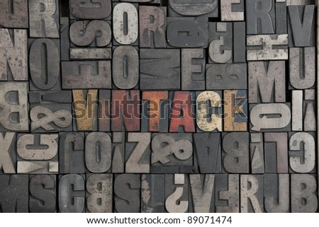 The word Vintage written in very old letterpress type - stock photo
