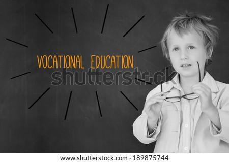 The word vocational education against schoolboy and blackboard - stock photo