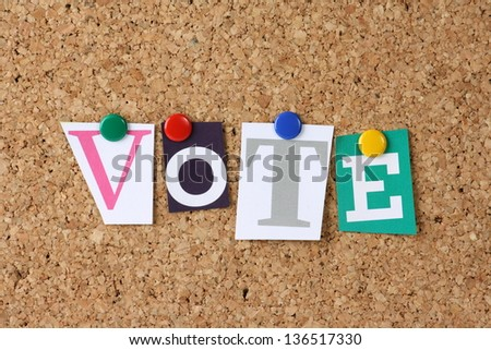 The word Vote in cut out magazine letters pinned to a cork notice board as a concept for democracy and choice - stock photo