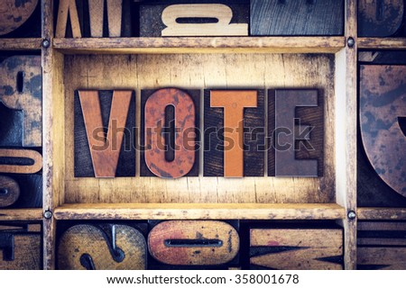 The word VOTE written in wooden letterpress type - stock photo