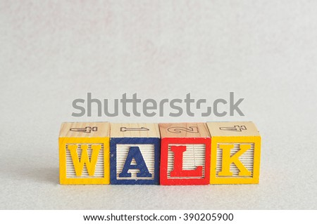 The word walk spelled with colorful alphabet blocks isolated against a white background - stock photo