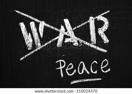 The word War in stencil letters on a blackboard is crossed out and replaced by the word Peace