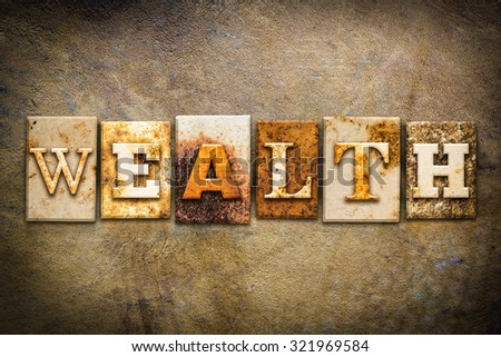 "The word ""WEALTH"" written in rusty metal letterpress type on an old aged leather background. - stock photo"