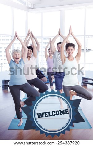 The word welcome and class standing in tree pose at yoga class against badge - stock photo