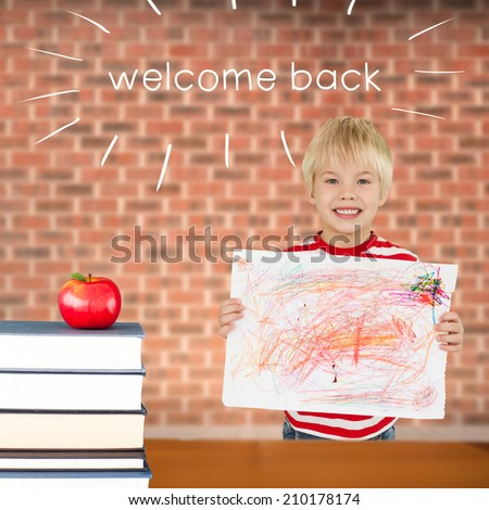 The word welcome back and cute boy showing his art against red apple on pile of books - stock photo