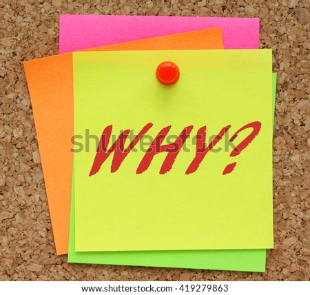 The word Why? in red text on a yellow sticky note pinned to a cork notice board