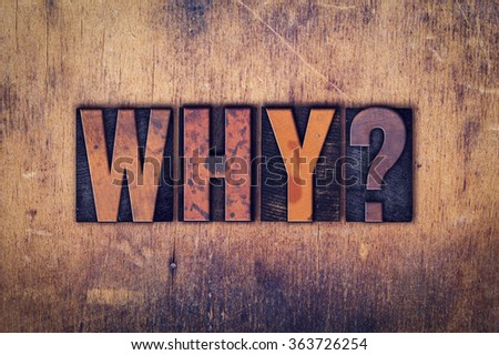 """The word """"Why"""" written in dirty vintage letterpress type on a aged wooden background. - stock photo"""