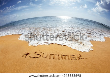 "The word with hashtag ""Summer"" in the sand against the sea - stock photo"