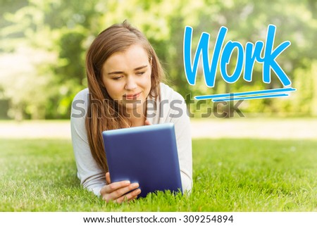 The word work against university student lying and using tablet pc - stock photo