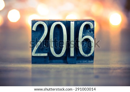 The word 2016 written in vintage metal letterpress type on a soft backlit background. - stock photo