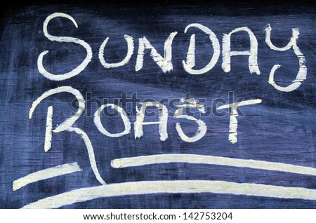 The wording text of Sunday Roast on a chalkboard. Concept photo of food and drinks. - stock photo