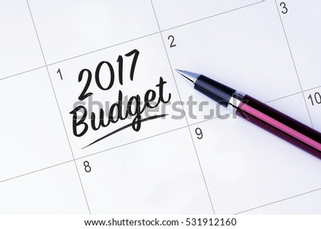 The words 2017 Budget on a calendar planner to remind you an important appointment with a pen on isolated white background. New Year concepts of goal and objective.