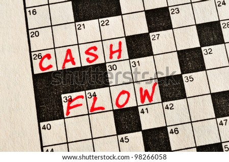 The Words Cash Flow on Crossword Puzzle in Red Ink, Copy Space - stock photo