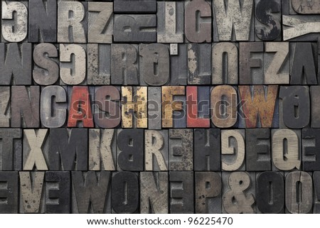 The words Cash Flow written in antique letterpress printing blocks. - stock photo