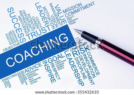 The words Coaching text cloud with a pen on isolated white background. Business concept text cloud.