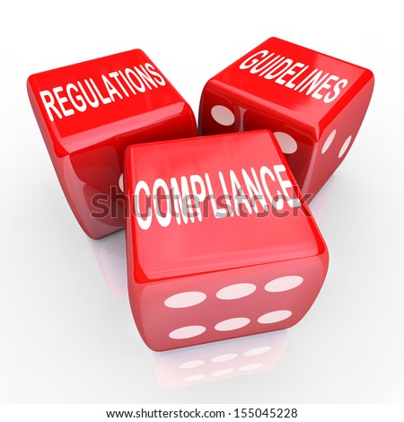 The words Compliance Regulations and Guidelines on three red dice to illustrate the need to follow rules and laws in conducting business - stock photo