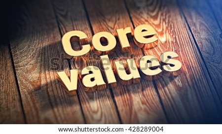 "The words ""Core values"" is lined with gold letters on wooden planks. 3D illustration image"