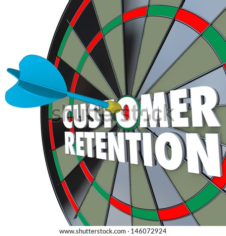 The words Customer Retention on a dartboard with a dart hitting a perfect bull's eye - stock photo