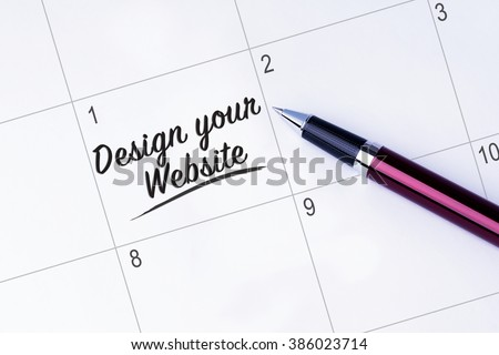 The words Design your website written on a calendar planner to remind you an important appointment with a pen on isolated white background.  - stock photo