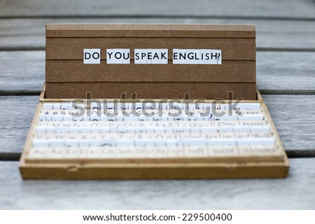 "the words ""do you speak english?"" on an old school letter box - stock photo"
