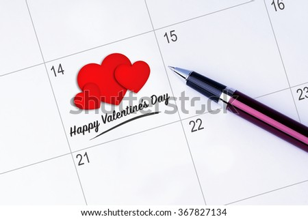 The words Happy Valentine's Day and 3 Heart Shape written on a calendar planner to remind you an important appointment with a pen on isolated white background. Valentine's Day and Love Concepts - stock photo