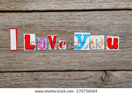 The words i love you in cut out magazine letters - stock photo