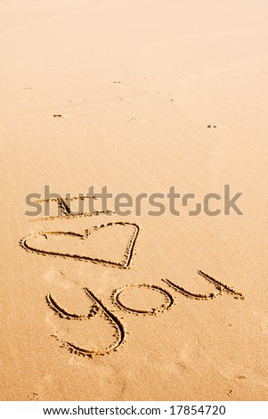 "The words ""I love you"" written on the beach sand - stock photo"
