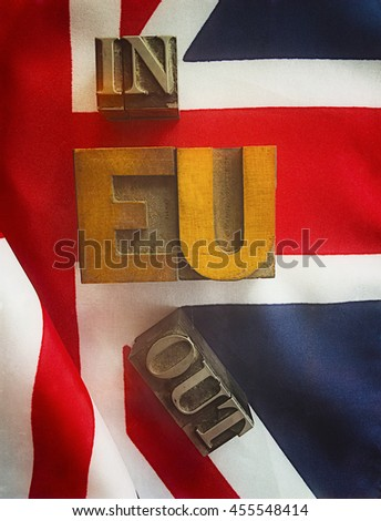 the words in and out in metal type with EU in wood type on a UK flag - stock photo