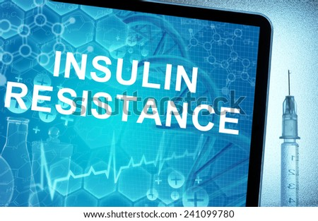 the words  Insulin Resistance on a tablet with syringe - stock photo