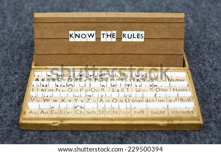 """the words """"know the rules"""" on an old school letter box - stock photo"""