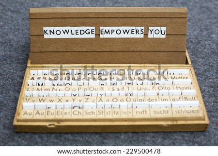 "the words ""knowledge empowers you?"" on an old school letter box - stock photo"
