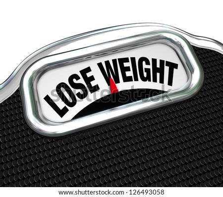 The words Lose Weight on the display of a scale to tell you you need to go on a diet to drop pounds and trim fat to improve your health - stock photo