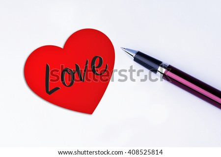 The words Love inside a Heart Shape to remind you an important appointment with a pen on isolated white background. Valentine's Day and Love Concepts - stock photo