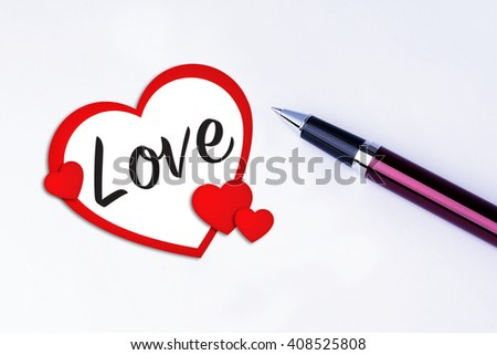 The words Love to remind you an important appointment with a pen on isolated white background. Valentine's Day and Love Concepts - stock photo