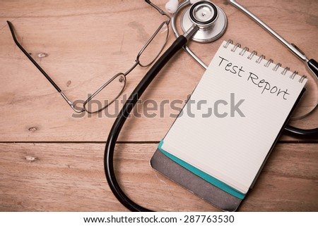 The words Medical appointment written on a white notebook to remind you an important appointment.