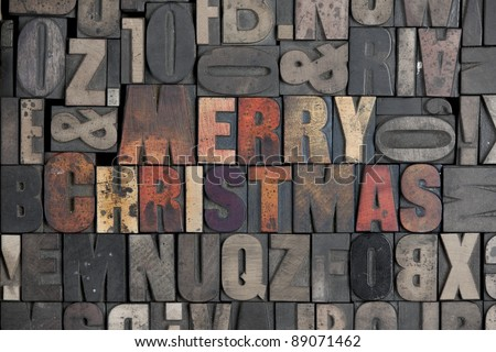 The words Merry Christmas written in very old letterpress type - stock photo